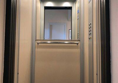 trasformazione ascensori con porta a battente a porte automatiche